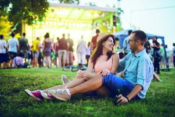 Young couple on an open air music event
